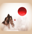 ink wash painting with big red sun and high misty vector image vector image