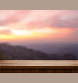 wood table top and blurred mountain landscape vector image