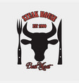 steak house logo with bulls head knife and fork vector image vector image