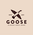 vintage canada goose duck flying logo icon vector image