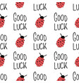 ladybug and good luck hand drawn lettering on vector image