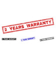 grunge 2 years warranty textured rectangle stamp vector image vector image