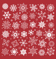 white snowflakes icon on red background vector image