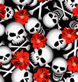 Skulls with red flowers seamless pattern vector image