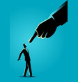businessman being pointed by giant finger vector image vector image