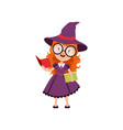 smart red-haired girl witch reading books and vector image vector image