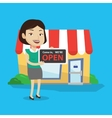 Female shop owner holding open signboard vector image vector image