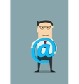 Businessman with e-mail symbol in hands vector image vector image