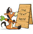 horse sitting at the table with a sign holding vector image vector image
