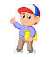 little boy holding a large book vector image vector image