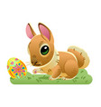 easter bunny with the egg on the grass cartoon vector image vector image