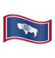 flag of wyoming waving on white background vector image vector image