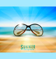 sunglasses lying on beach in sand on a vector image vector image