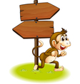 A monkey running beside the empty arrowboards vector image vector image