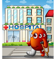 A multi-eyed monster in front of the hospital vector image vector image