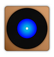 black plate with blue center on brown background vector image
