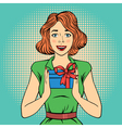 Pop Art Happy Woman Holding a Gift in comic style vector image vector image