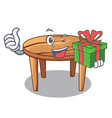 with gift cartoon wooden dining table in kitchen vector image