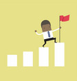 businessman holding a flag on top the graph vector image