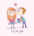 boy gives gift to girl and kisses cheek vector image