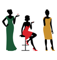Silhouettes of women dressed in evening dress vector image