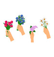 hands holding bouquets vector image