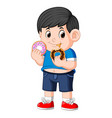little happy cute boy is eating two donut vector image