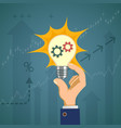 light bulb with gears in the hand of a businessman vector image vector image
