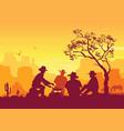cowboys around a campfire western american desert vector image vector image
