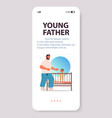 young father playing with little son in crib vector image