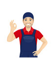 man in overalls gesturing ok sign vector image