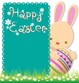 Rabbit and easter eggs on green grass vector image vector image