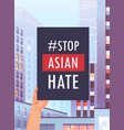 stop asian hate human hand holding banner against vector image vector image