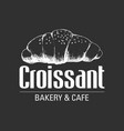 Sketch of a croissant on black background
