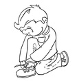 Black and white boy tying a shoelace vector image