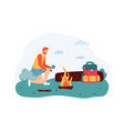 man sitting near campfire and drinking cup tea vector image vector image