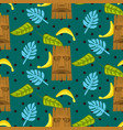 tiki mask and palm leaves seamless pattern vector image