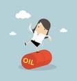 businesswoman balancing on oil barrel rolling vector image vector image