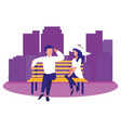 couple sitting on bench cityscape vector image