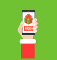 hand holding smartphone with free gif box on the vector image vector image