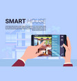 hand holding digital tablet with smart home vector image