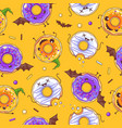 seamless halloween pattern with kawaii donuts vector image
