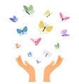 butterflies flying from open hands vector image vector image