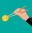 hand businessman with chopsticks with coin vector image vector image