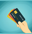 human hand holding a credit card vector image