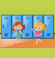 two girls in front of lockers vector image