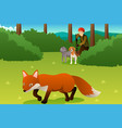 hunter with his dogs hunting a fox vector image vector image