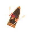 man in cap rowing wooden boat top view vector image vector image