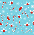 christmas pattern with holly berries candy canes vector image vector image