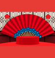 red podium with fan and chinese wall background vector image vector image